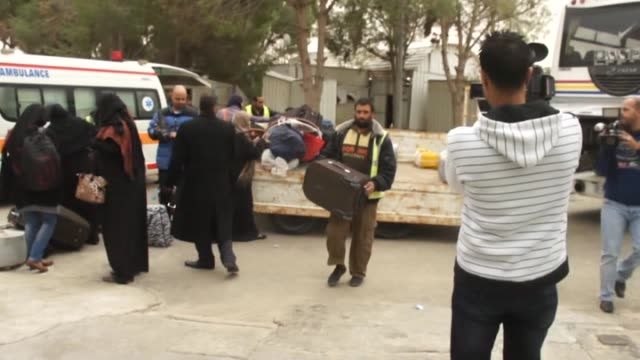 gazans carry their luggage as they cross from rafah border to gaza on november 27 in rafah gaza egyptian authorities kept the rafah border crossing... - carry on luggage stock videos and b-roll footage