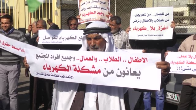 gazans take part in a protest rally over ongoing electricity power cuts outside the power plant in gaza city gaza on december 02 2017 - plant part stock videos and b-roll footage