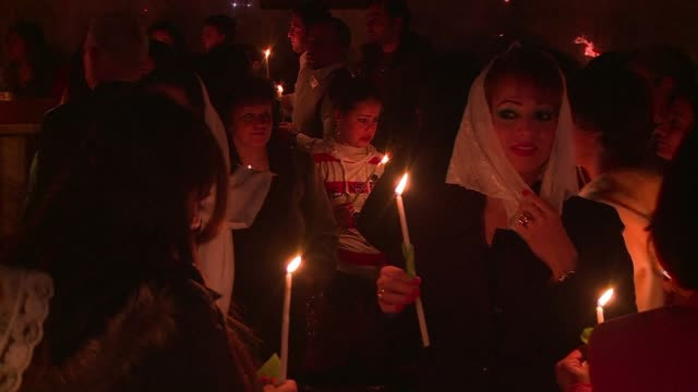 gazas orthodox christians marked easter with a midnight mass, holding candles and praying - midnight stock videos & royalty-free footage
