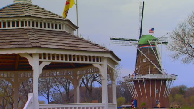 gazebo in the foreground with windmill in the background - gazebo stock videos & royalty-free footage