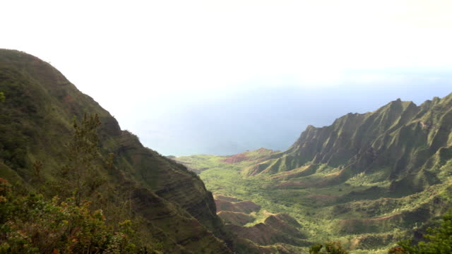 gazing out at ocean surrounding kauai island from far above - butte rocky outcrop stock videos & royalty-free footage