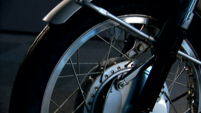 gears and spokes crisscross a bicycle tire. - crisscross stock videos & royalty-free footage
