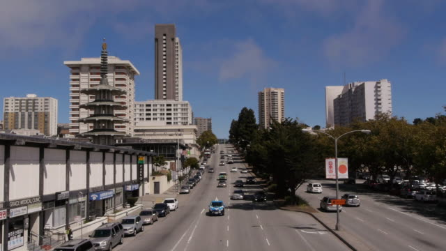 ws geary blvd with traffic in japantown in san francisco - pagoda stock videos & royalty-free footage