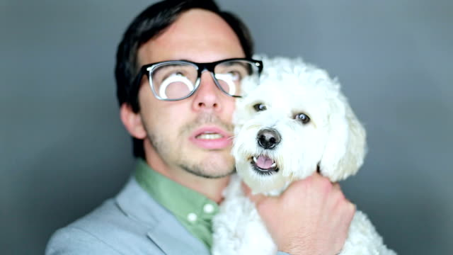 geek embracing adorable white doggie - geek stock videos & royalty-free footage