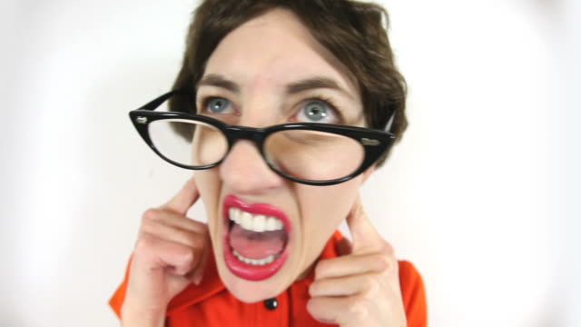 geeky woman covering her ears refusing to listen - cat's eye glasses stock videos and b-roll footage