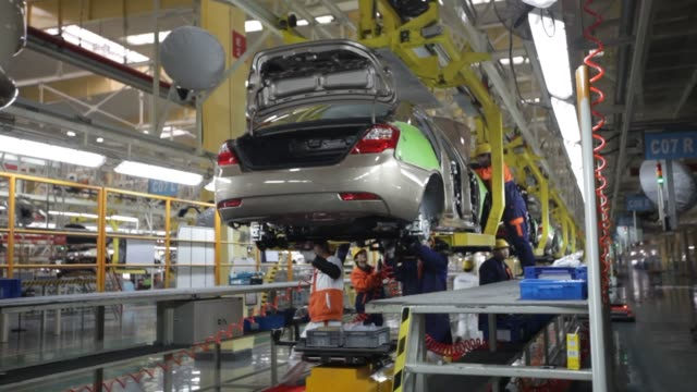 geely automobile manufacturing china economy assembly line auto workers geely auto manufacturing on february 05 2013 in cixi china - zhejiang province stock videos & royalty-free footage