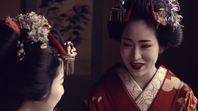 geisha maiko together indoor by window slow motion 4k - sandal stock videos & royalty-free footage