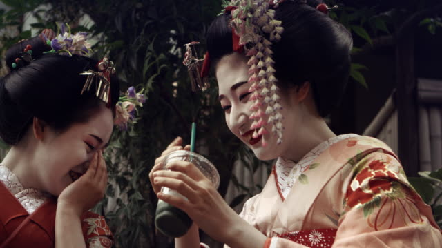 geisha maiko together laughing outdoorslow motion 4k - kimono stock videos & royalty-free footage