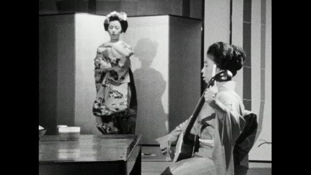 ws geisha performing traditional dance in geisha house; 1966 - femininity stock videos & royalty-free footage
