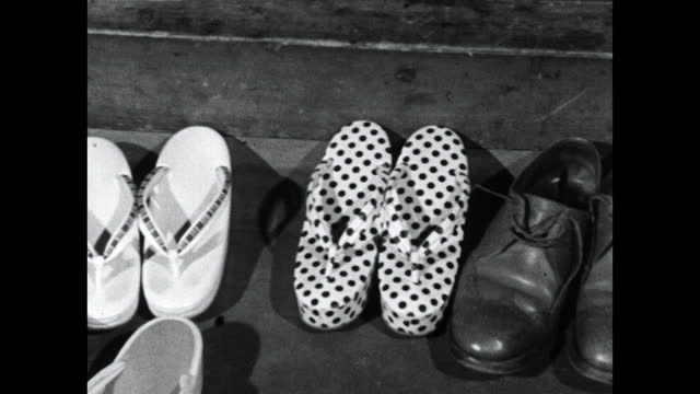 geisha sandals lined up alongside english brogues; 1964 - social grace stock videos & royalty-free footage