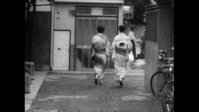 geisha walking on street in higashiyama district of kyoto; 1959 - femininity stock videos & royalty-free footage