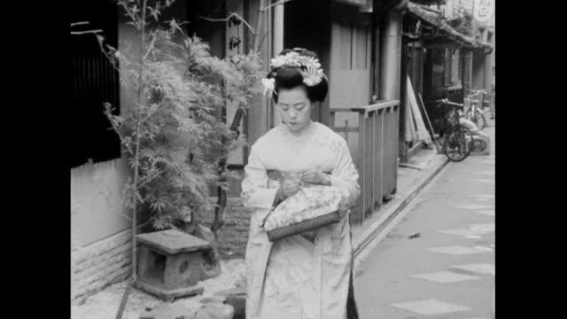 geisha walks noisily along paved street in japan; 1966 *audio* - femininity stock videos & royalty-free footage