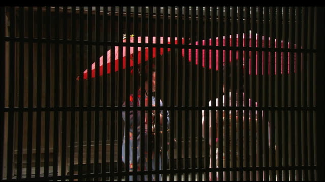 geishas viewed through lattice fence - kimono stock videos & royalty-free footage