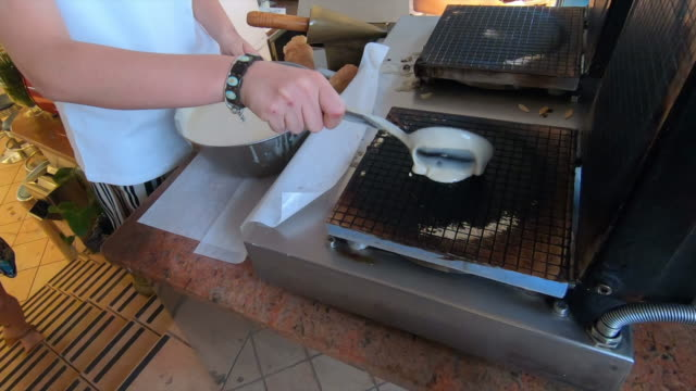 gelato and cones being made in capri island, italy, europe. - slow motion - waffle iron stock videos and b-roll footage