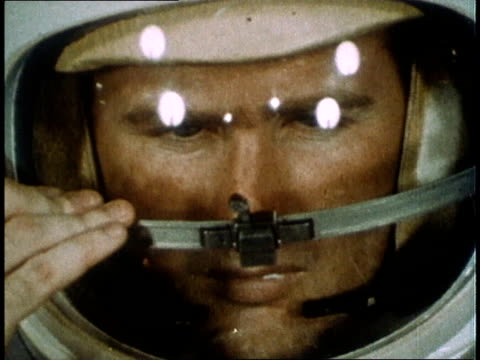gemini iv astronaut demonstrating spacesuit and helmet / united states - gemini 4 stock videos and b-roll footage