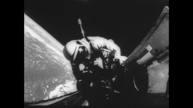 Gemini pilot Richard Gordon's space walk / Gordon attaches tether to Gemini XI to attach to Agena target vehicle / view 400 miles above the earth...