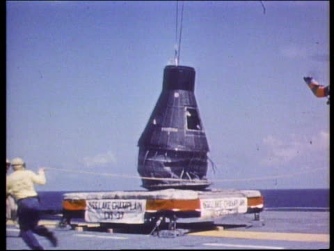 gemini space capsule being lowered to aircraft carrier - splashdown stock videos and b-roll footage