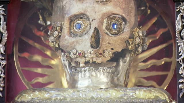 ecu tu td gem-studded skull in reliquary in st. peter's church, munich, bavaria, germany - gem stock videos and b-roll footage