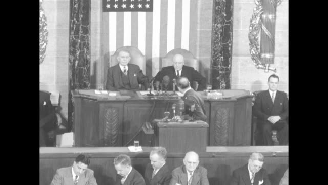 gen douglas macarthur and others walking down aisle joint session of congress members standing and applauding / they walk to chairs and podium /... - sam rayburn video stock e b–roll