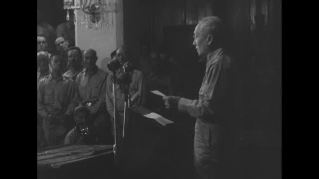 stockvideo's en b-roll-footage met us gen douglas macarthur finishes his speech at malacanang palace in manila departs podium / rear shot he shakes hands with filipino president sergio... - douglas macarthur