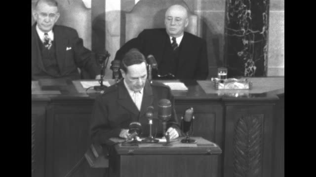 gen douglas macarthur speaks to us vice president alben barkley prior to his speech before a joint session of the us congress house speaker sam... - sam rayburn video stock e b–roll