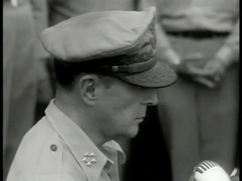 gen douglas macarthur standing uss missouri ha ws japanese delegates and generals watching us naval soldiers bg ms macarthur signing treaty sept 2... - general macarthur stock videos & royalty-free footage