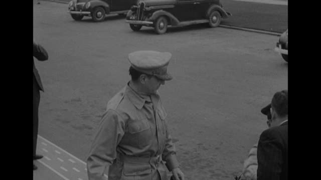 gen douglas macarthur supreme commander of southwest pacific area getting out of car with another officer and being greeted by australian deputy... - general macarthur stock videos & royalty-free footage