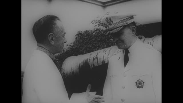 us gen douglas macarthur wearing uniform featuring the army staff identification badge shakes hands with philippines president manuel quezon as they... - general macarthur stock videos & royalty-free footage
