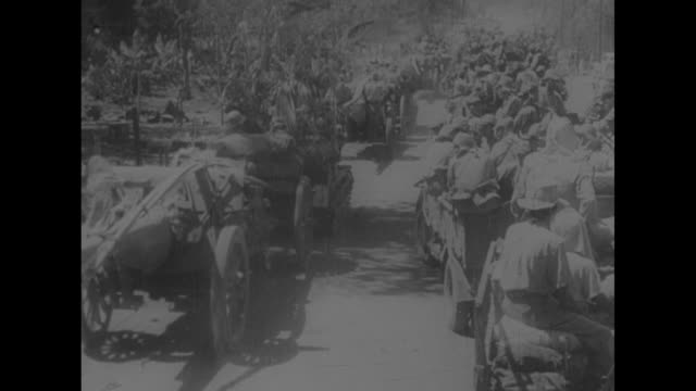 stockvideo's en b-roll-footage met vo gen douglas macarthur's 1945 speech turning over the philippines government to sergio osmena vs us military forces ride through streets of... - douglas macarthur