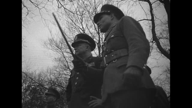 gen. dwight eisenhower and british officers walk on grounds of royal military college , pass cadets doing training on obstacle course / tilt-up shot... - cadet stock videos & royalty-free footage