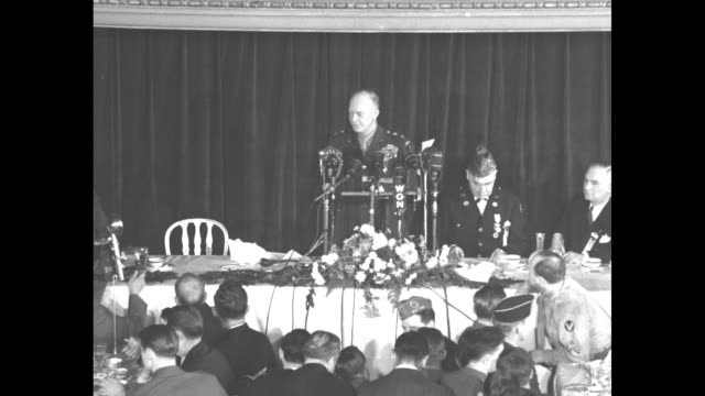 US Gen Dwight Eisenhower begins his address to the American Legion's Chicago National Convention Committee luncheon as photographers take photos he...