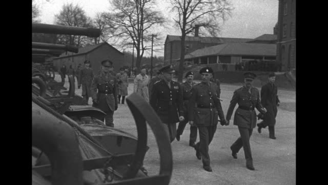 gen. dwight eisenhower walks on the campus of royal military college ; he salutes three women of the british auxiliary territorial service as he... - 士官候補生点の映像素材/bロール