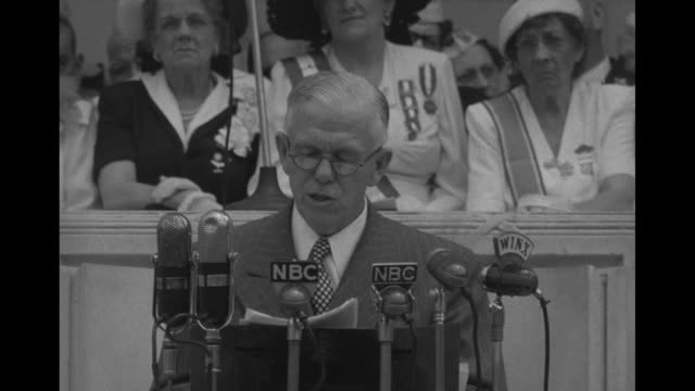 CU Gen George Marshall in civilian clothing speaking in front of microphones can see a few women seated behind him
