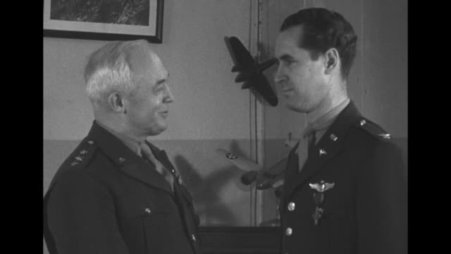 VS Gen Henry 'Hap' Arnold Chief of Army Air Forces pins Distinguished Service Cross on Colonel Walter Sweeney hero of Battle of Midway as SOT Arnold...
