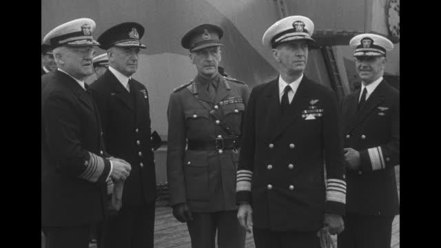 vs gen john dill admiral dudley pound adm harold stark elliott roosevelt and gen george marshall on deck of hms prince of wales - generale grado delle forze armate video stock e b–roll