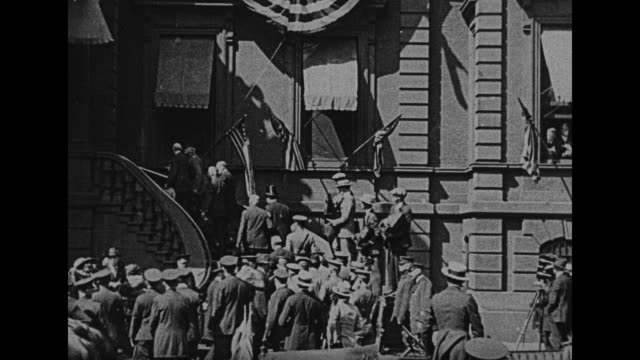 gen john j pershing arrives at elaborately decorated facade and climbs stairs to balcony hundreds of people with attempted crowd control by police... - john pershing stock videos & royalty-free footage