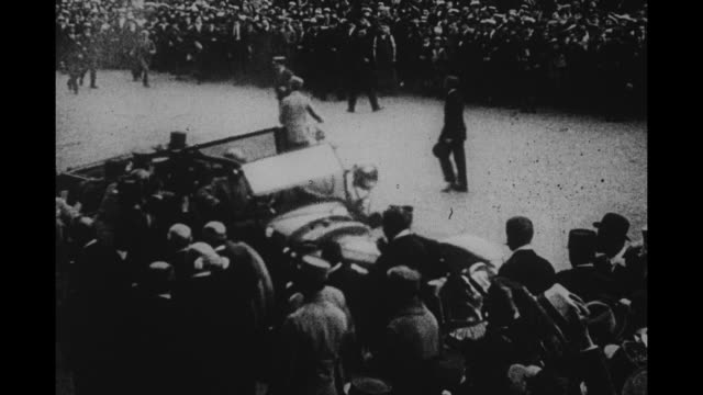 us gen john pershing arrives at hotel de crillon with large crowd looking on - john pershing stock videos & royalty-free footage