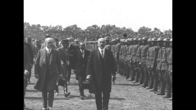 / us gen john pershing arrives at the stadium and reviews troops with french president raymond poincare / soldiers marching past carrying flags and... - john pershing stock videos & royalty-free footage