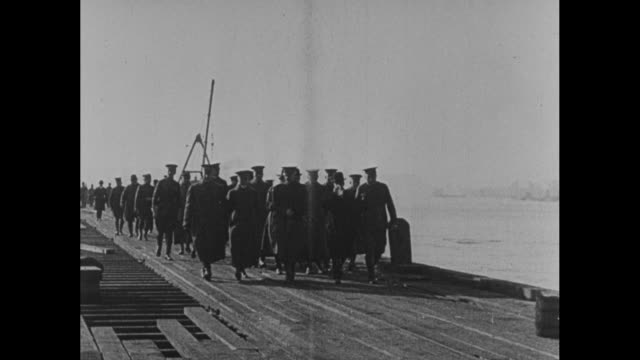 vídeos de stock, filmes e b-roll de gen john pershing french gen joseph joffre and us secretary of war newton baker walking with group of officers along railroad tracks cranes and ship... - oficial posto militar