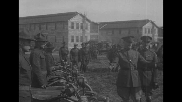 gen. john pershing inspects motorcycles with wooden barracks at rear; he and officers astride horses watch long line of trucks covered with canvas... - cavalry stock videos & royalty-free footage