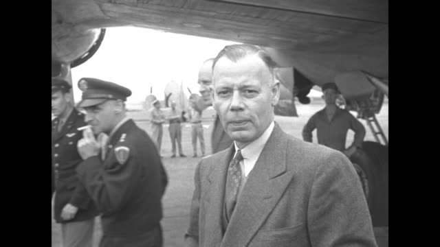us gen lucius clay deplanes with officials in suits all are photographed on tarmac man on left might be diplomat robert d murphy / note exact year... - lucius d. clay stock videos and b-roll footage
