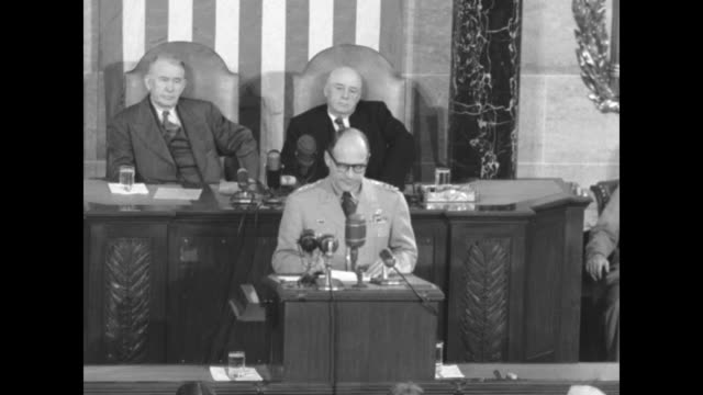 gen matt ridgway speaking at podium with microphones vice president alben barkley and speaker of the house sam rayburn seated behind others seated in... - sam rayburn video stock e b–roll