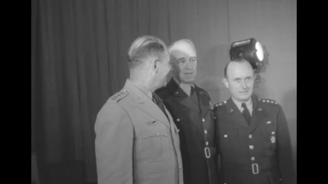 gen matthew ridgway commander of un forces in korea gen omar bradley chairman of joint chiefs of staff and third officer standing together for photo... - joint chiefs of staff stock videos and b-roll footage