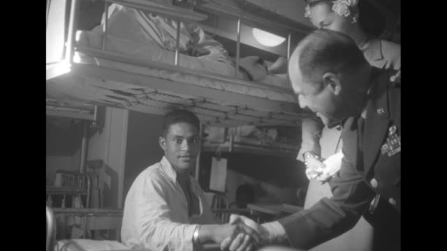 vs gen matthew ridgway commander of us/un forces in korea greets wounded soldiers in their hospital bunks on board the ms jutlandia a danish hospital... - matthew b. ridgway stock-videos und b-roll-filmmaterial