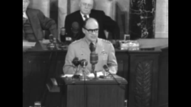 us gen matthew ridgway speaking in front of microphones / ridgway can partly see speaker of the house sam rayburn and vice president alben barkley /... - sam rayburn stock videos and b-roll footage