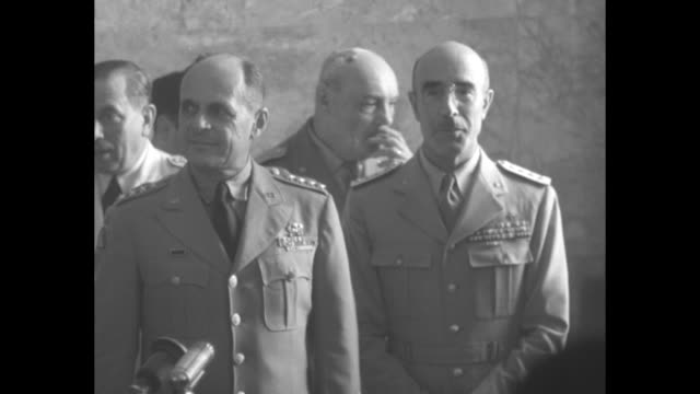 Gen Matthew Ridgway Supreme Allied Commander Europe with entourage at press conference during his inspection of NATO forces in West Germany...