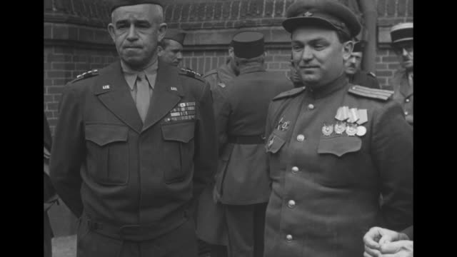 Gen Omar Bradley stands outdoors with Russian officer prior to ceremony at which Soviets will turn over part of the Berlin Occupation Zone to the US...