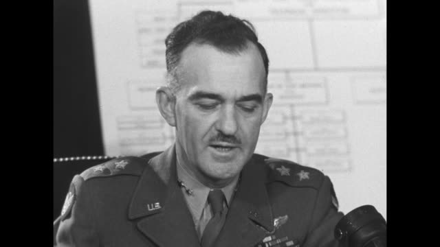 cu gen william kepner deputy force commander army air forces at atomic tests sitting at desk speaking to camera / note exact month/day not known - atomic bomb testing stock videos & royalty-free footage