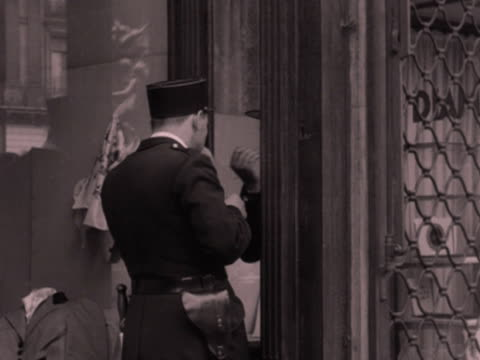 a gendarme checks his face in a mirror in a shop window 1952 - admiration stock videos & royalty-free footage