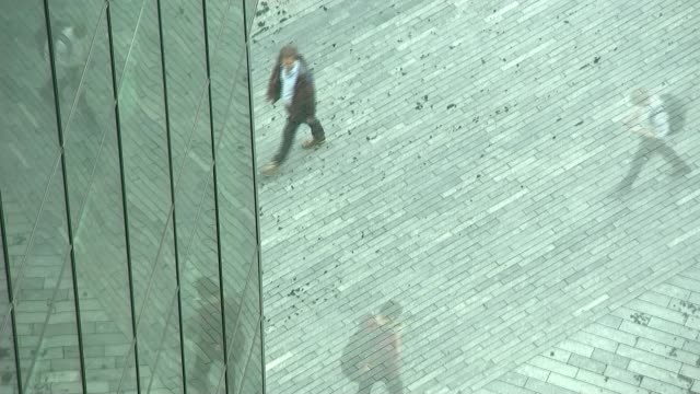 gender pay gap in london; date unknown time lapse sequence workers along seen from above city buildings - unknown gender stock videos & royalty-free footage